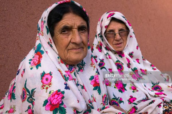 Iran, Isfahan Province, Abyaneh, portrait of iranian women wearing traditional floreal chadors in zoroastrian village